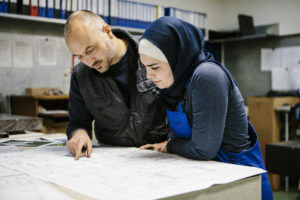 Teamwork: two technician discuss about the plan for next steps