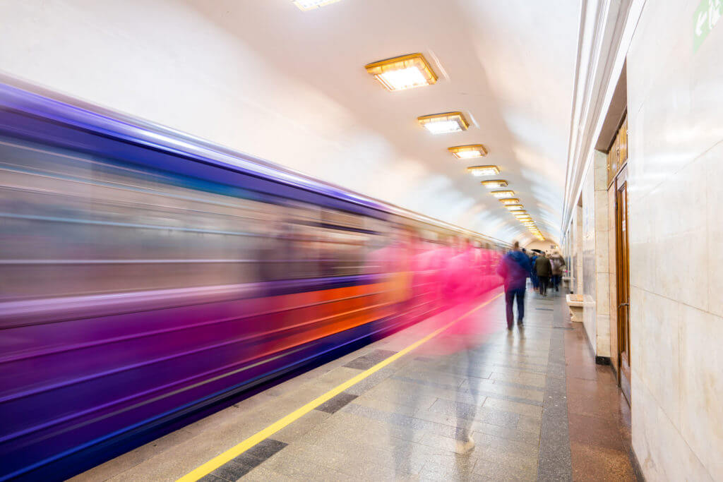 Metro Station with blurred train passing through