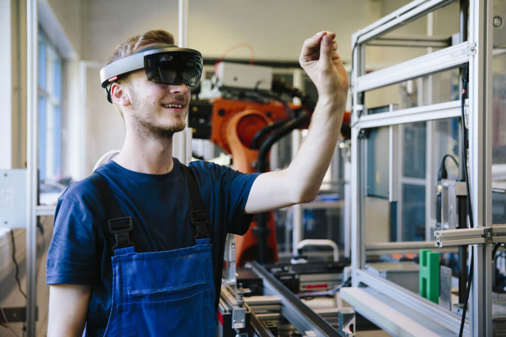 Young engineer works with a head-mounted display