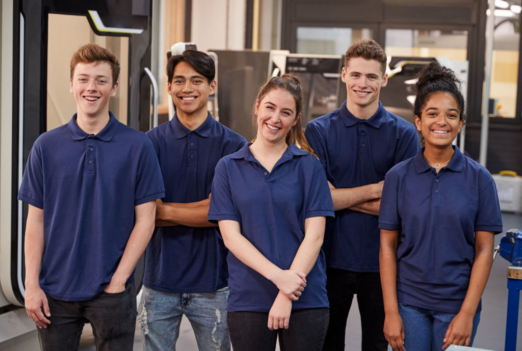 Portrait Of Engineering Apprentices In Factory