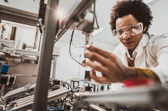 Female engineer working on industrial machine